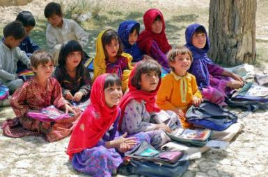 School children in Afghanistan sitting outdoors